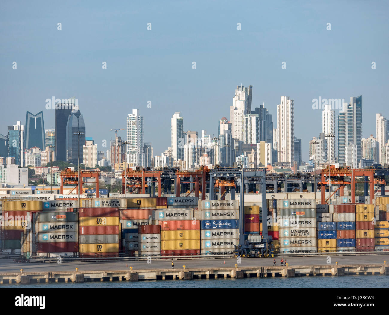 Shipping Containers At The Port Of Bilboa And Panama City Skyline On The Entrance To The Panama Canal Stock Photo