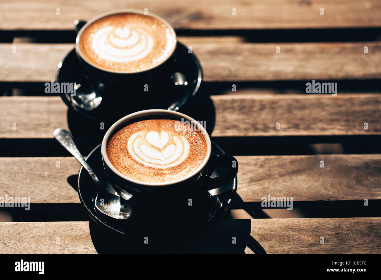 Two cups of cappuccino with latte art - Stock Image