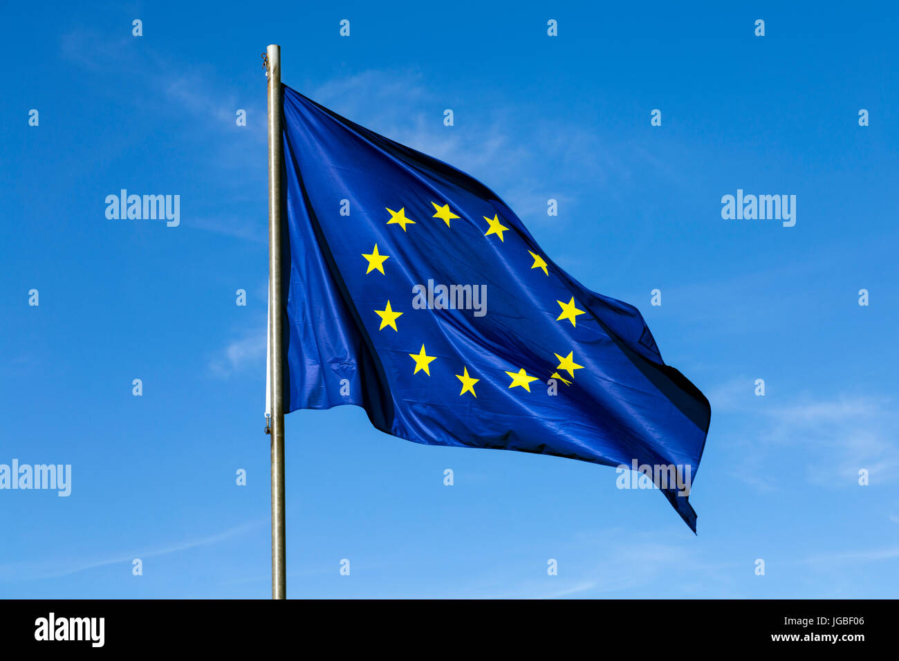 European Union flag against a blue sky background - Stock Image