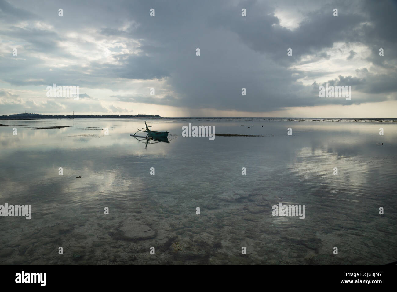 Seascape with coral scrap with boat at Gili Air, Lombok, Indonesia - Stock Image