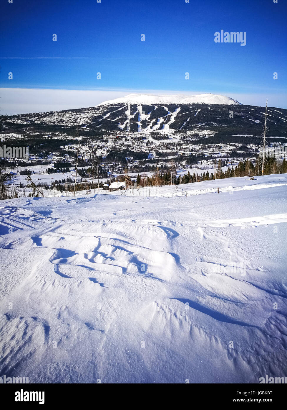 Distant view of mount Trysilfjellet, Trysil, Norway from across the valley. Norway's biggest ski resort. Sunny - Stock Image
