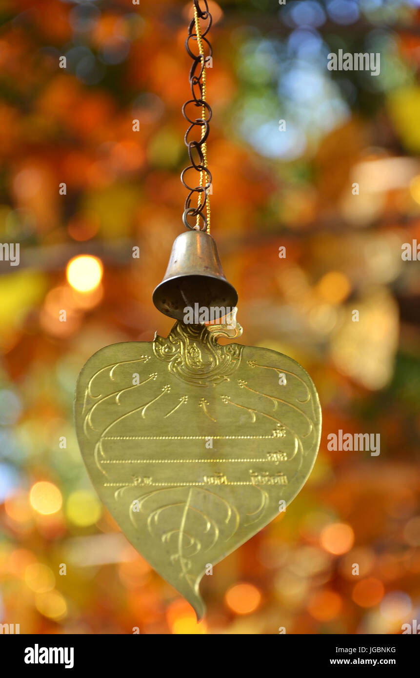 Gold leaf and bell for write the wish ,Thailand - Stock Image