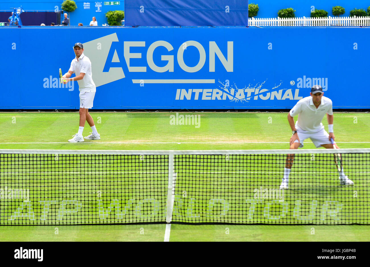 Mike and Bob Bryan  in a doubles match at the Aegon International tournament, Eastbourne 2017. Mike serving (right - Stock Image