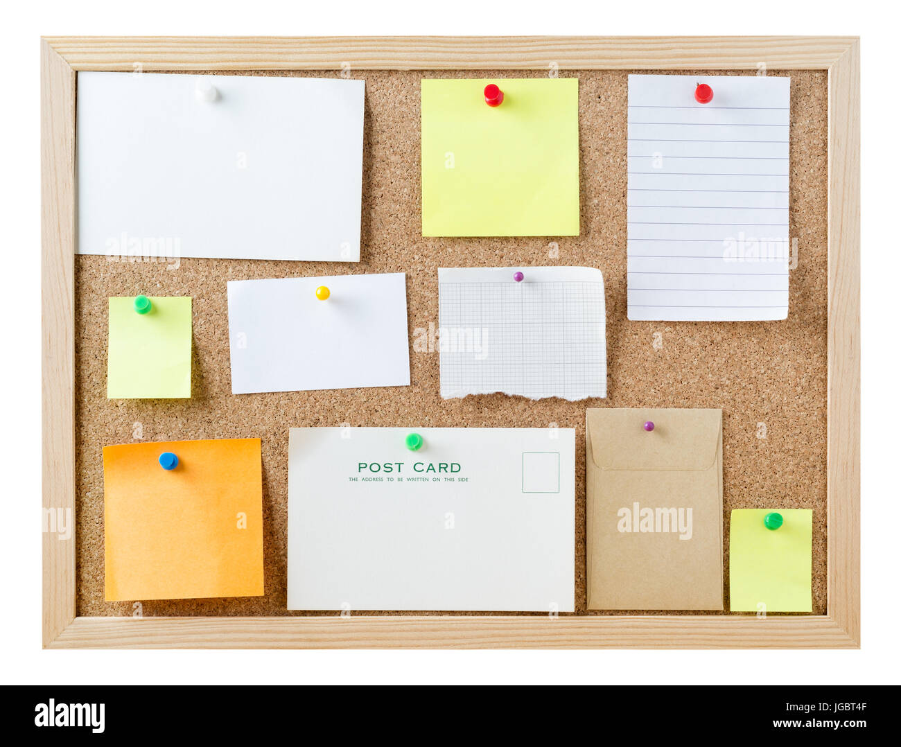 A cork pinboard, isolated on white, with a variety of pushpins sticky notes, cards and pieces of paper, left blank - Stock Image