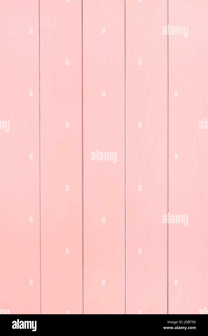 Photograph of a painted tongue and grooved wood plank panel in warm pink.  Shot vertically. - Stock Image
