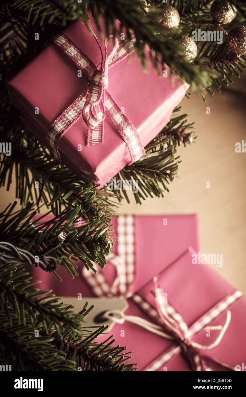 Pink Christmas.Pink Christmas Gift Boxes In Branches And Around Base Of