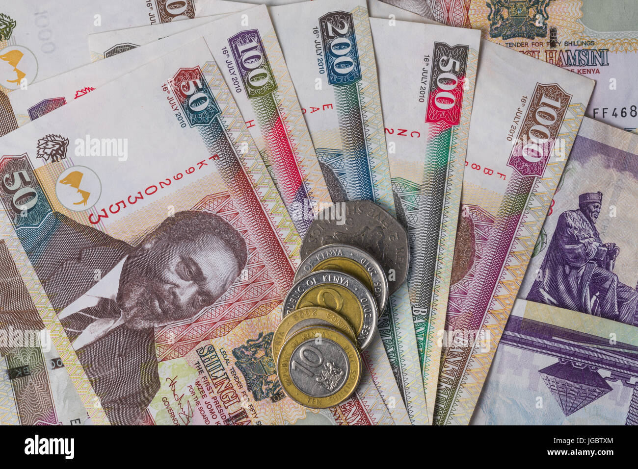 Kenyan Shilling Bank Notes And Coins In Various Denominations - Stock Image