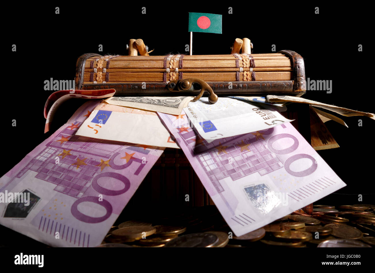 Bangladeshi flag on top of crate full of money - Stock Image