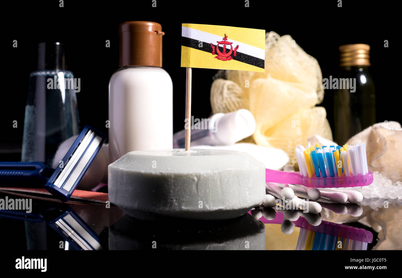 Brunei flag in the soap with all the products for the people hygiene - Stock Image