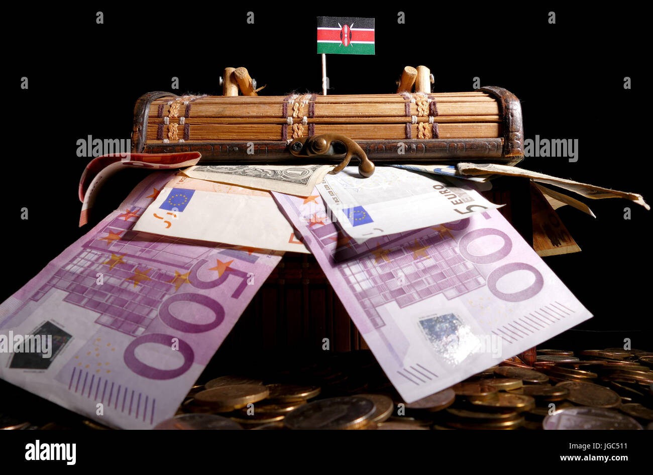 Kenyan flag on top of crate full of money Stock Photo