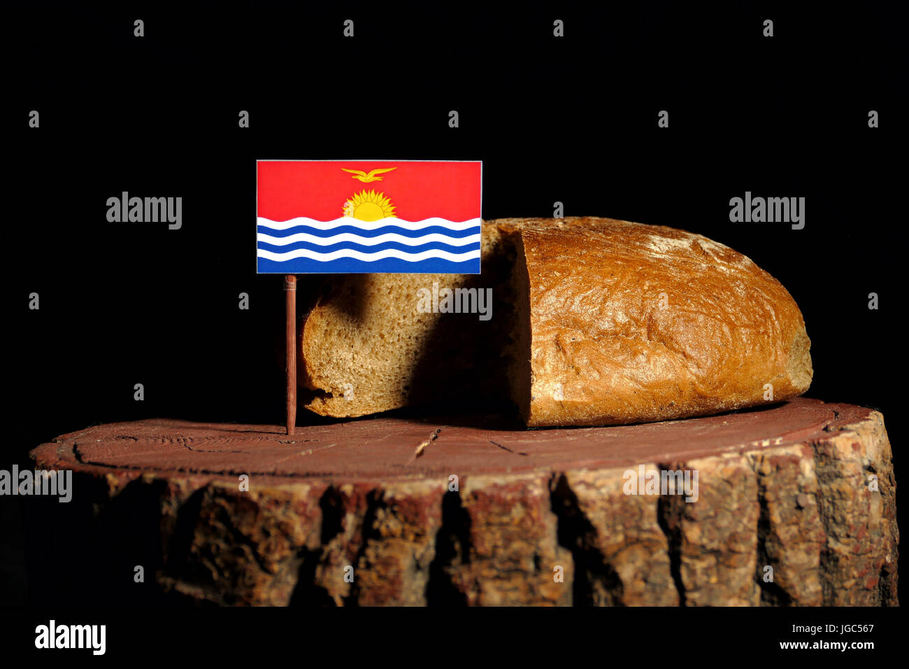 Kiribati flag on a stump with bread isolated - Stock Image