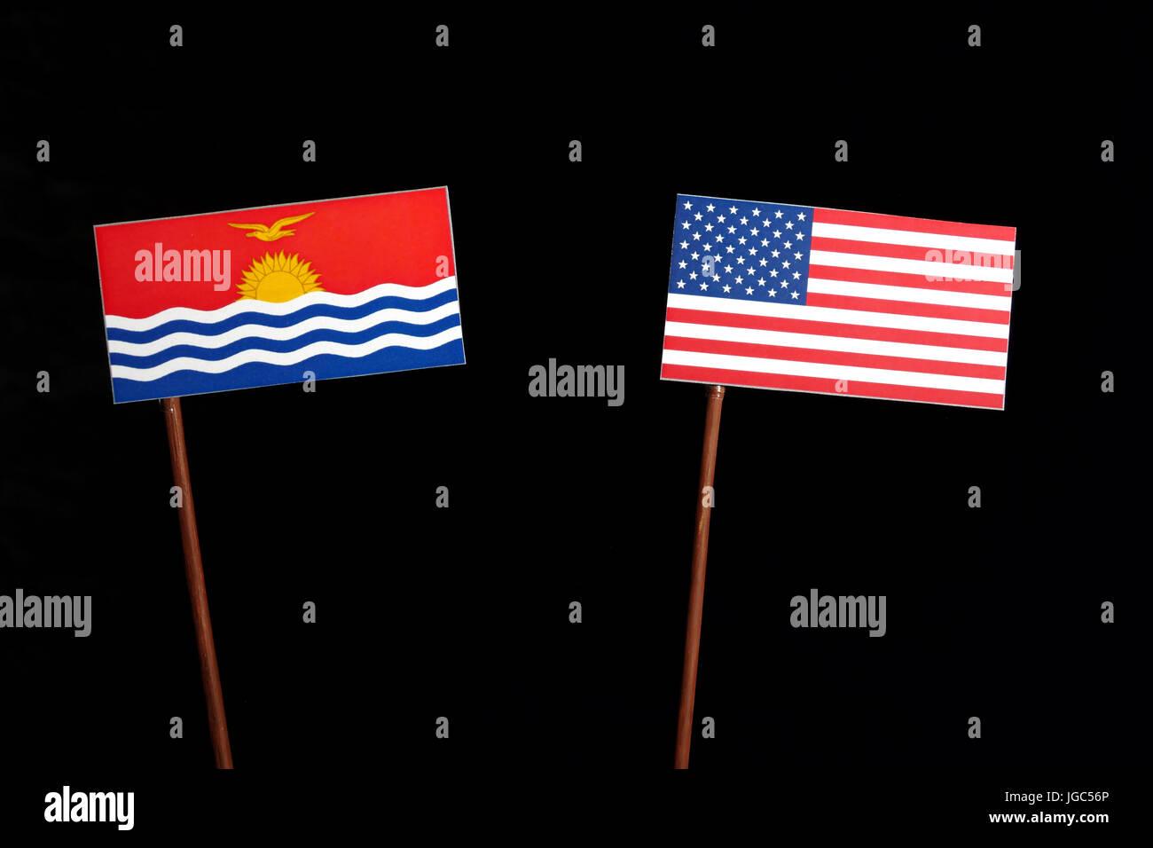 Kiribati flag with USA flag isolated on black background - Stock Image