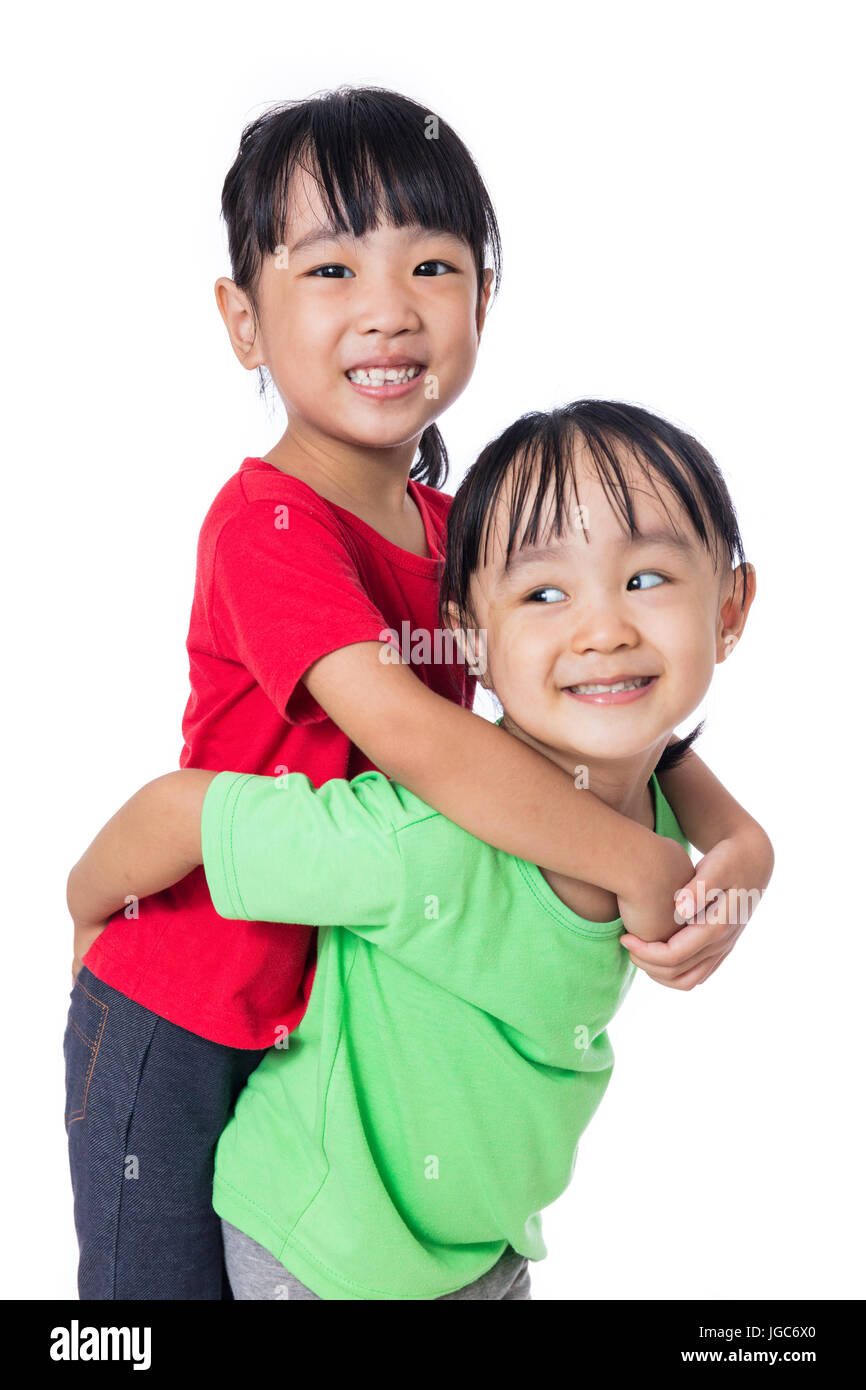 Asian Chinese little girls playing together in isolated white background - Stock Image
