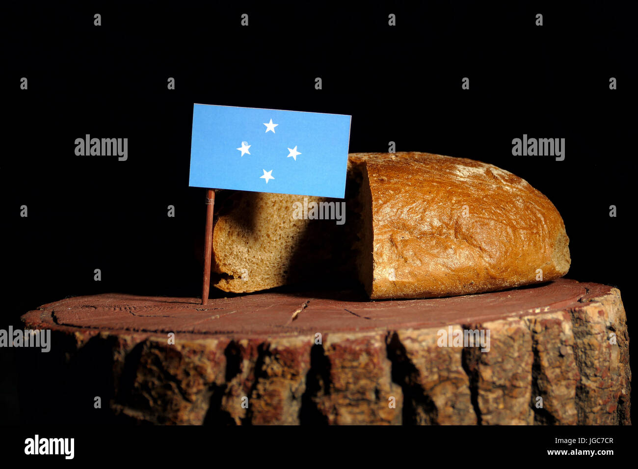 Micronesian flag on a stump with bread isolated - Stock Image