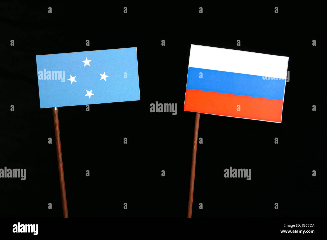 Micronesian flag with Russian flag isolated on black background - Stock Image