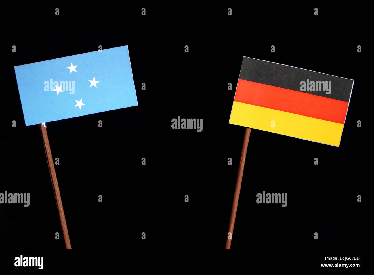 Micronesian flag with German flag isolated on black background - Stock Image