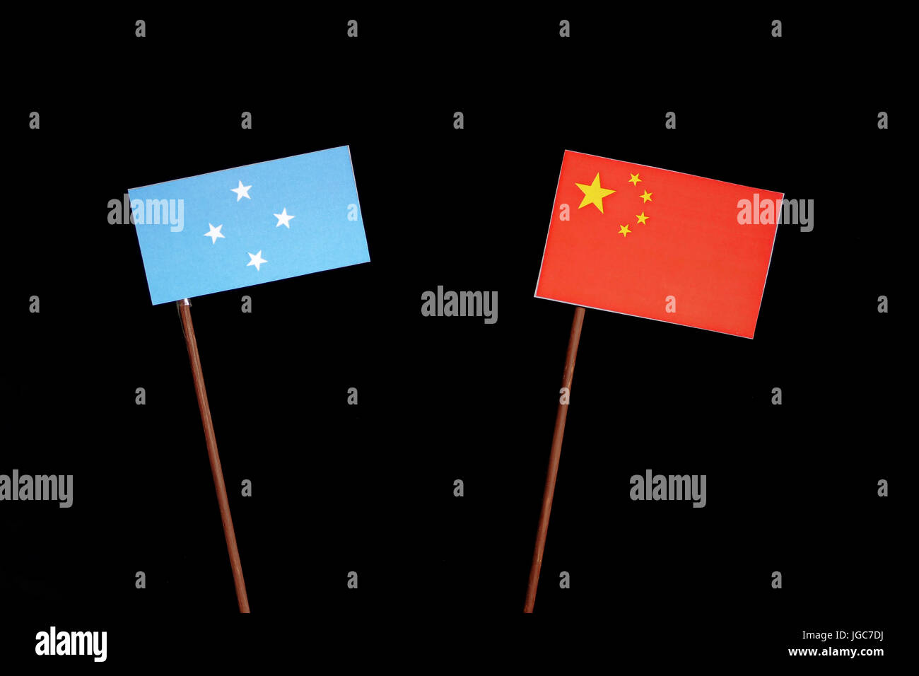Micronesian flag with Chinese flag isolated on black background - Stock Image