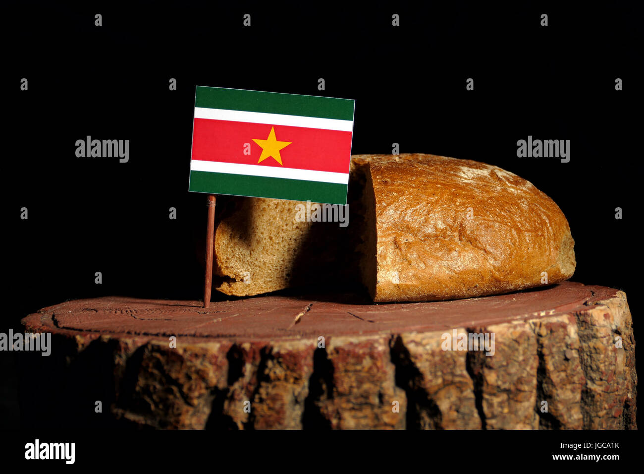 Suriname flag on a stump with bread isolated - Stock Image