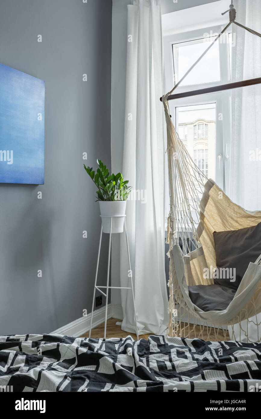 Gray, Scandinavian Style Bedroom With Hammock, Bed And Window
