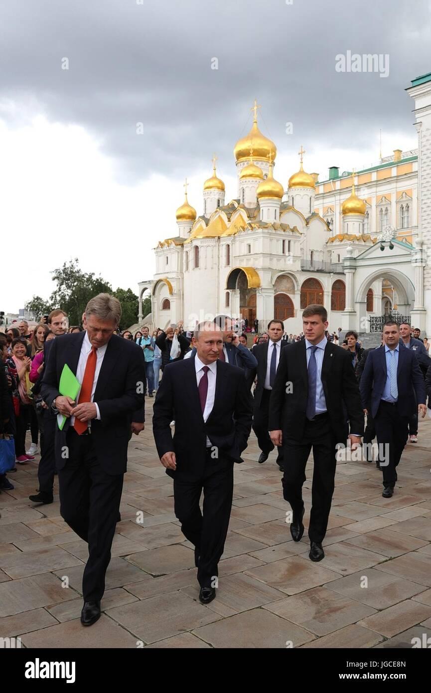 Russian President Vladimir Putin walks through the grounds of the Kremlin alongside presidential spokesman Dmitry - Stock Image
