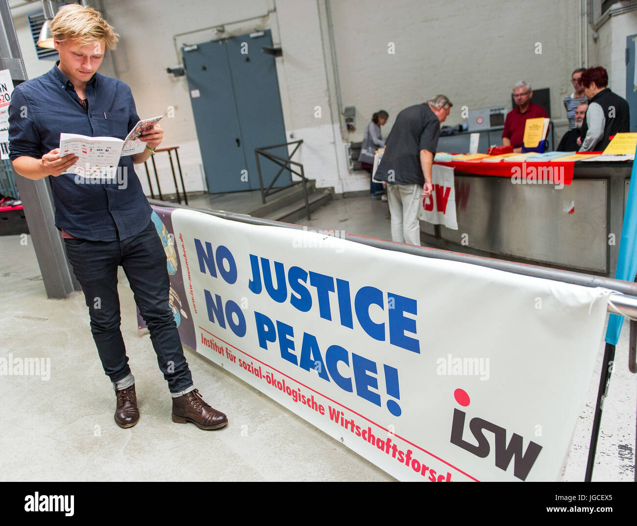 Hamburg, Germany. 5th July, 2017. A visitor reads a brochure at the Global Solidarity Summit in Hamburg, Germany, - Stock Image