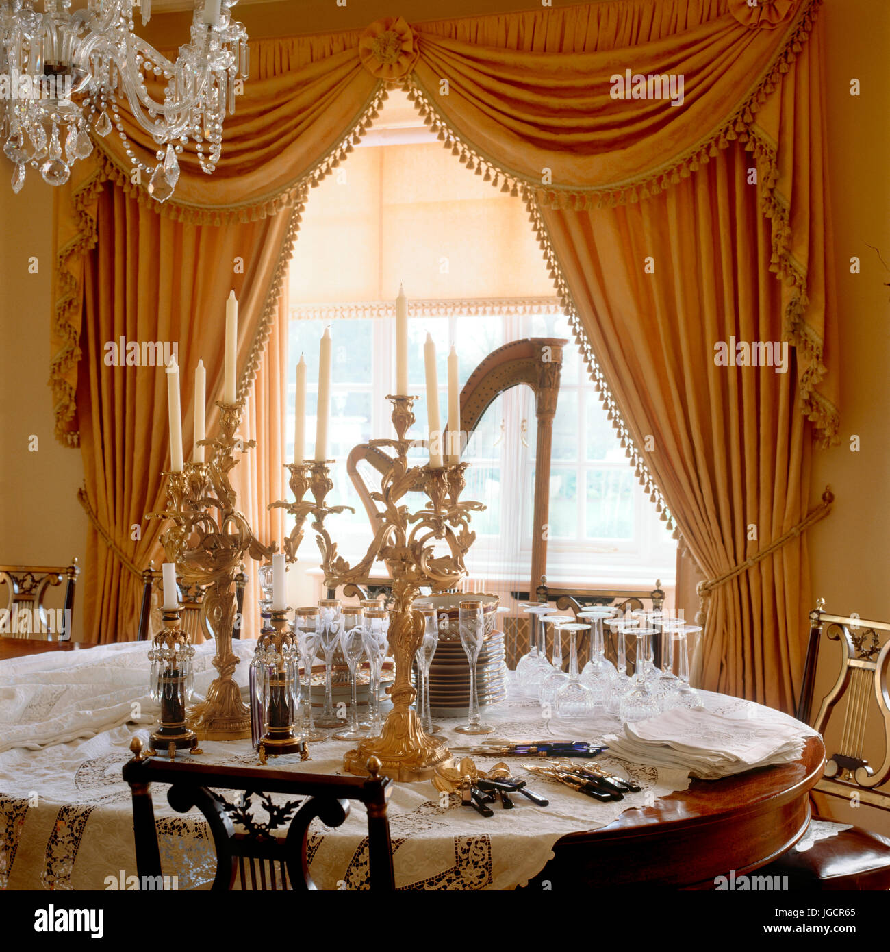 Opulent dining room with open curtains - Stock Image