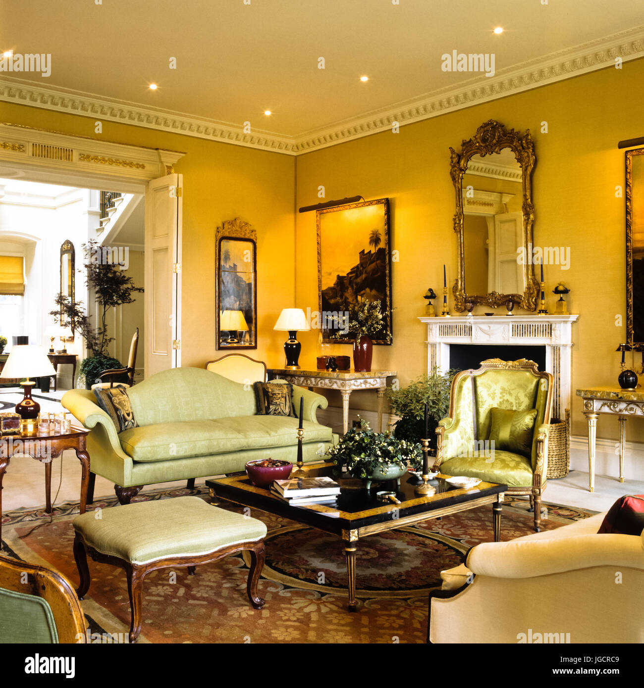 Edwardian living room with green seating - Stock Image
