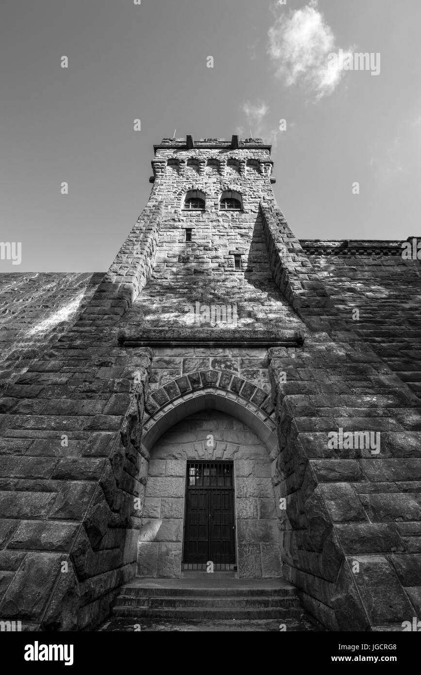 Looking up at the solid stone tower at Derwent reservoir in the Peak District, Derbyshire, England. - Stock Image