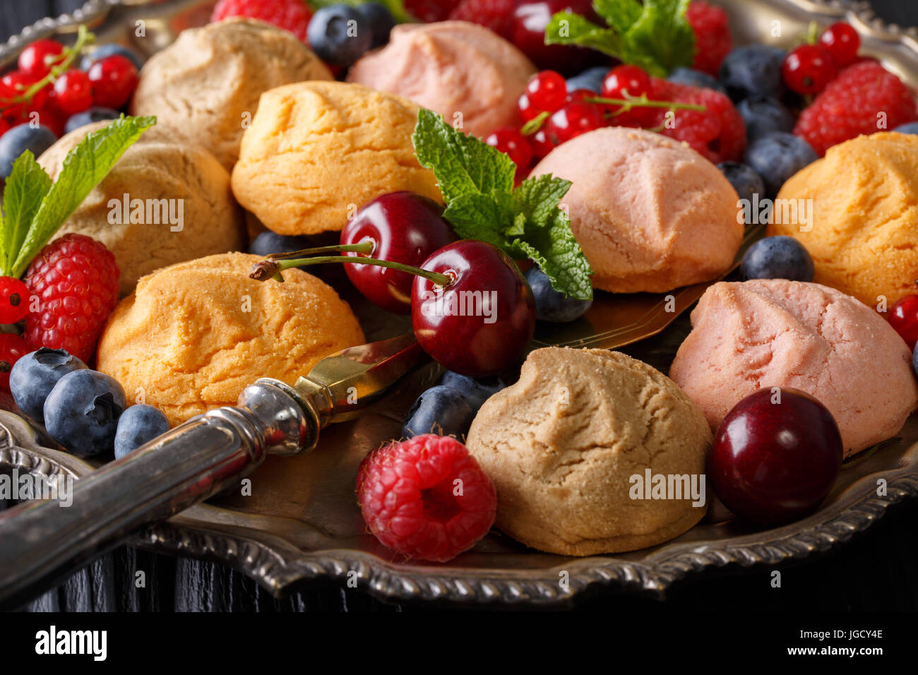 Beautiful food background: cookies and fresh berries close-up in a dish. horizontal - Stock Image