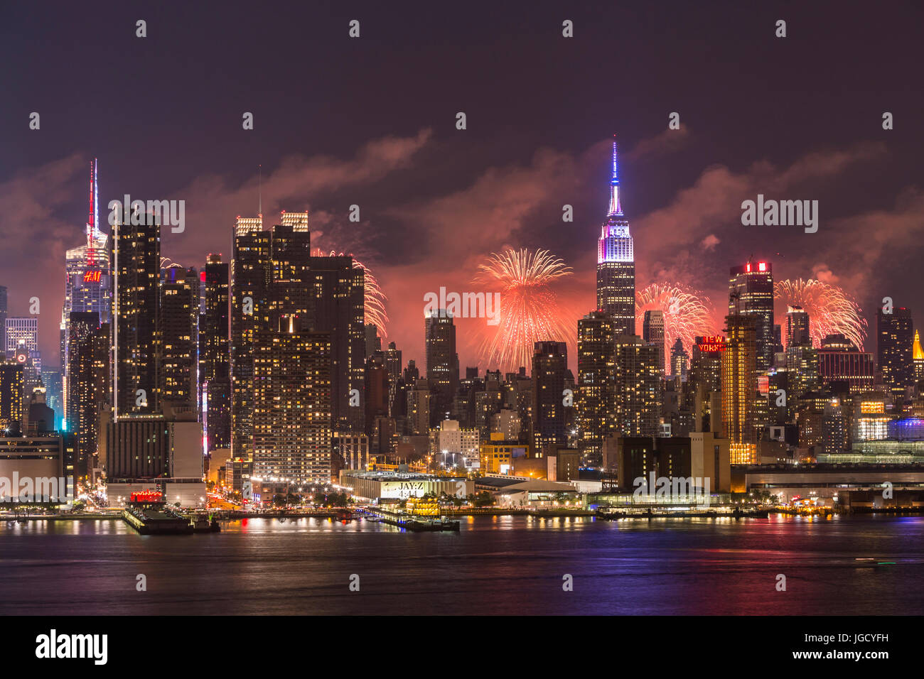 The annual Macy's Fourth of July fireworks show lights the sky behind the Manhattan skyline in New York City as Stock Photo