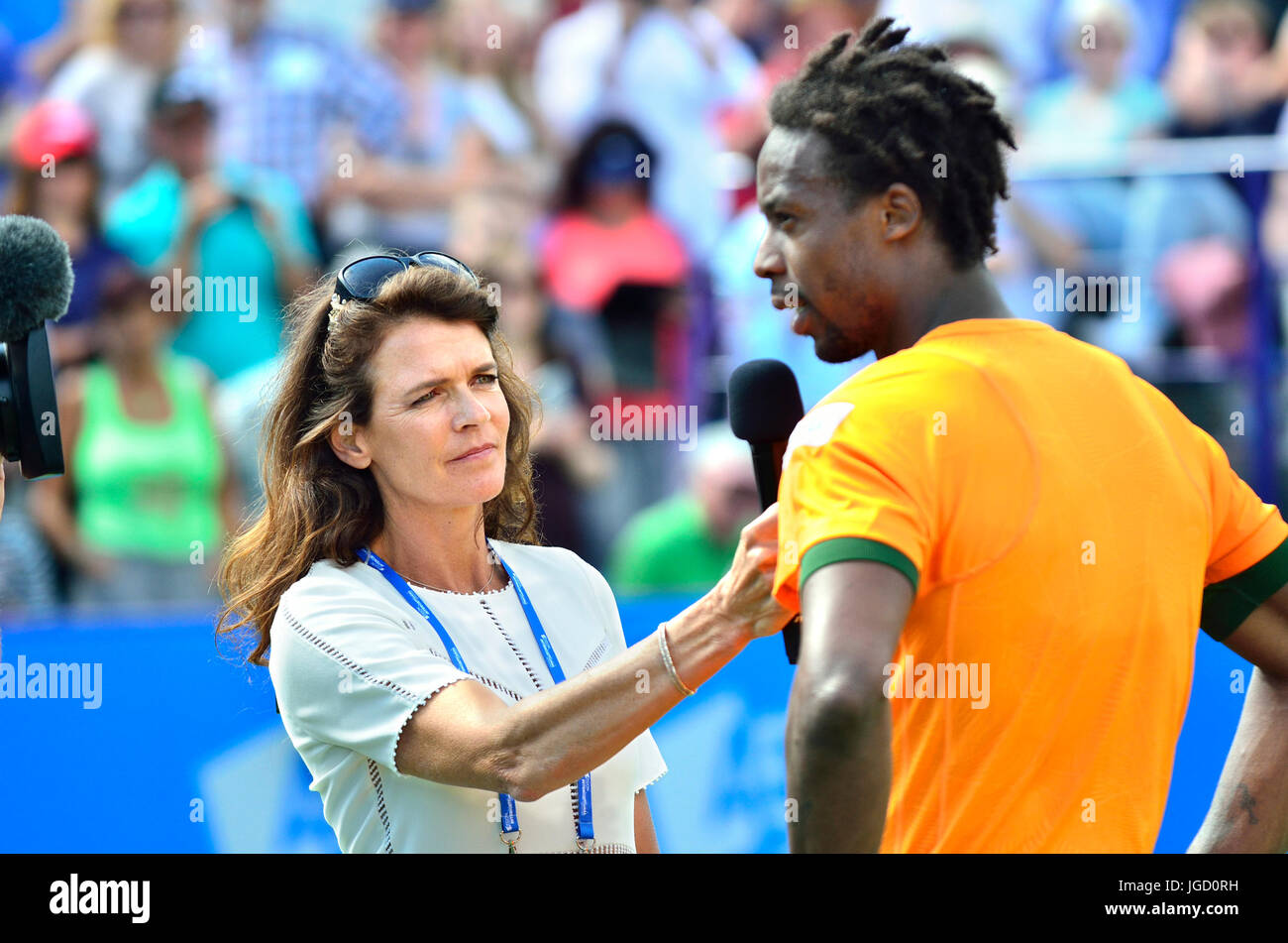 Annabel Croft, former British no 1 tennis player, interviewing Gael Monfils on centre court after the final of the - Stock Image