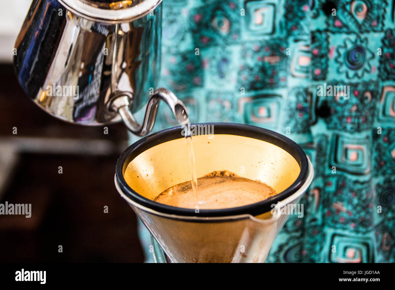 Pour over into a gold filter, Revolver Cafe, Cambie Street, Vancouver, Canada - Stock Image