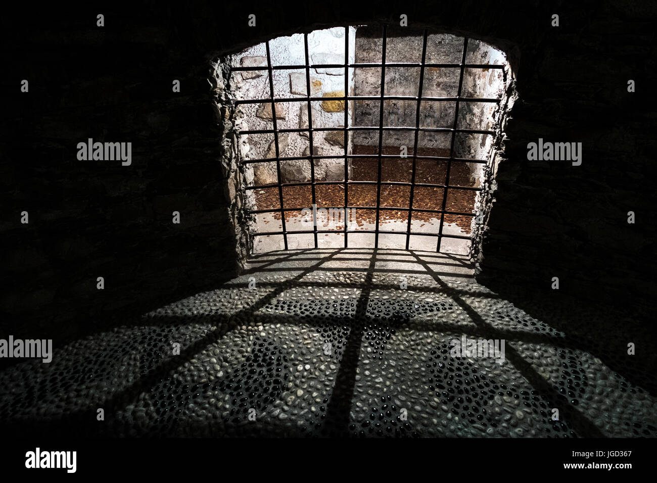 dungeon old dark prison medieval cell bars Stock Photo