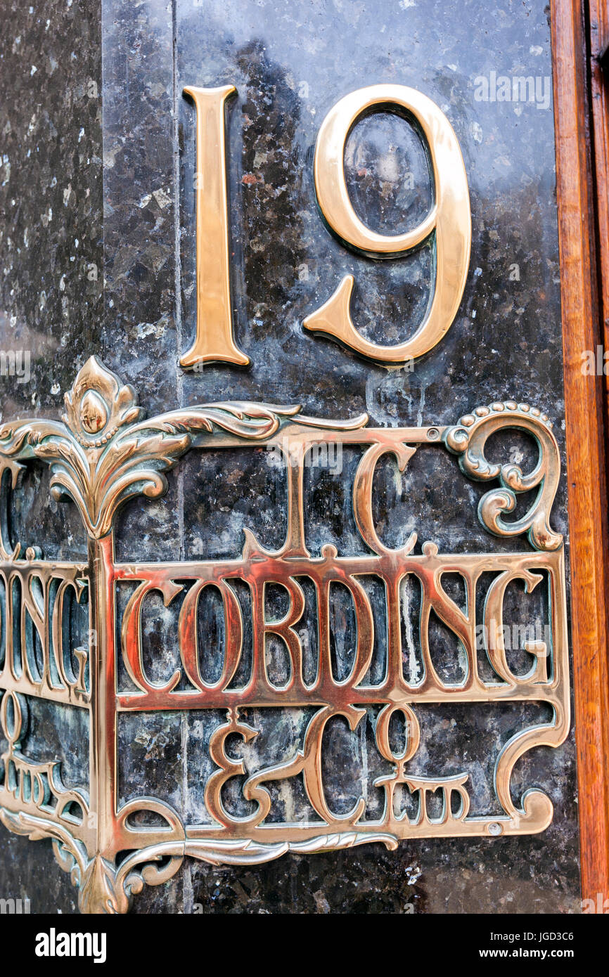 Street number, 19 Piccadilly London, J.C. Cording & Co Ltd. - Stock Image