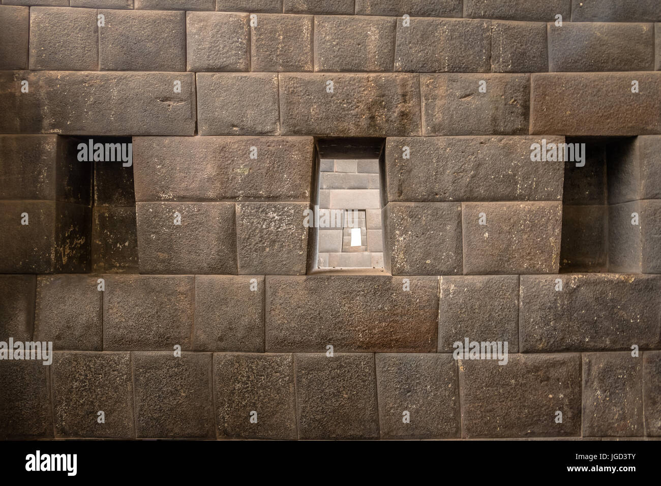 The three trapezoidal windows and Inca Wall of Rainbow Temple at Qoricancha Inca Ruins - Cusco, Peru - Stock Image