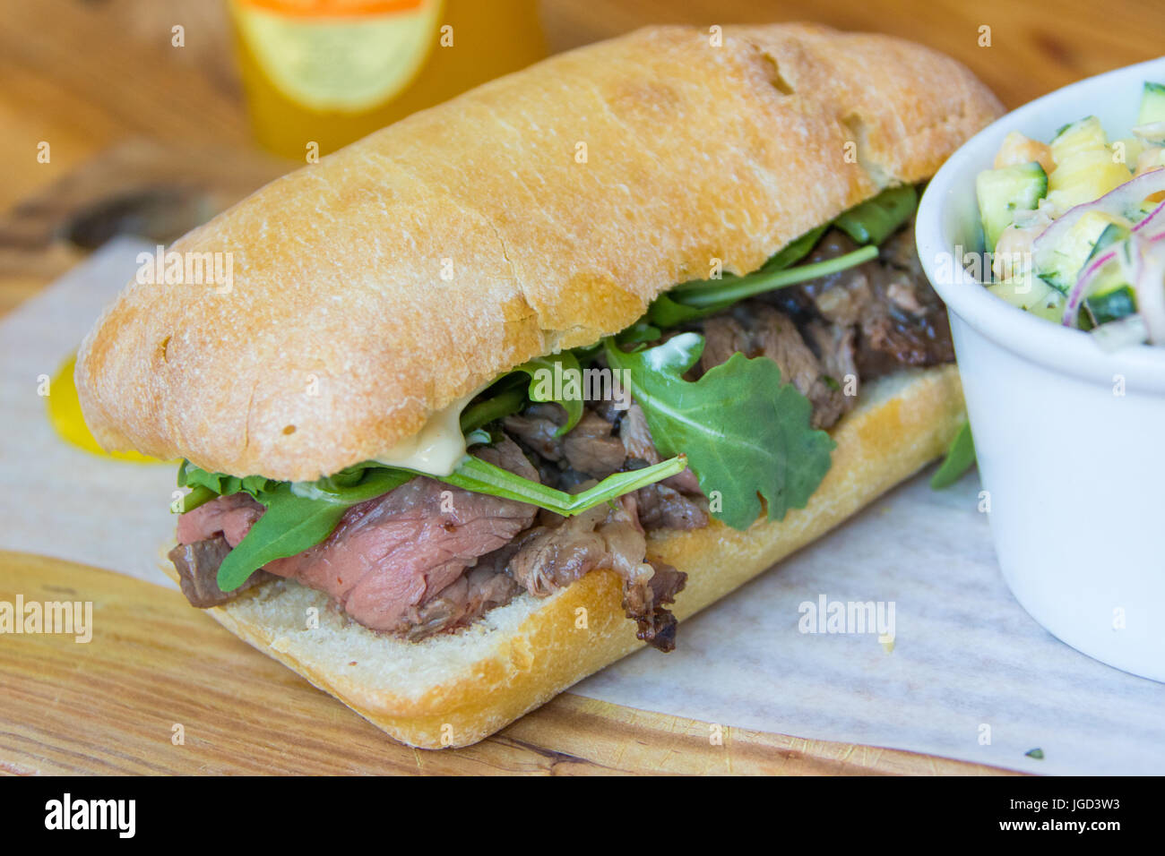 Prime rib, arugula, and garlic mayo sandwich, zucchini chickpea salad at Meat and Bread Restaurant, Gastown, Vancouver, - Stock Image