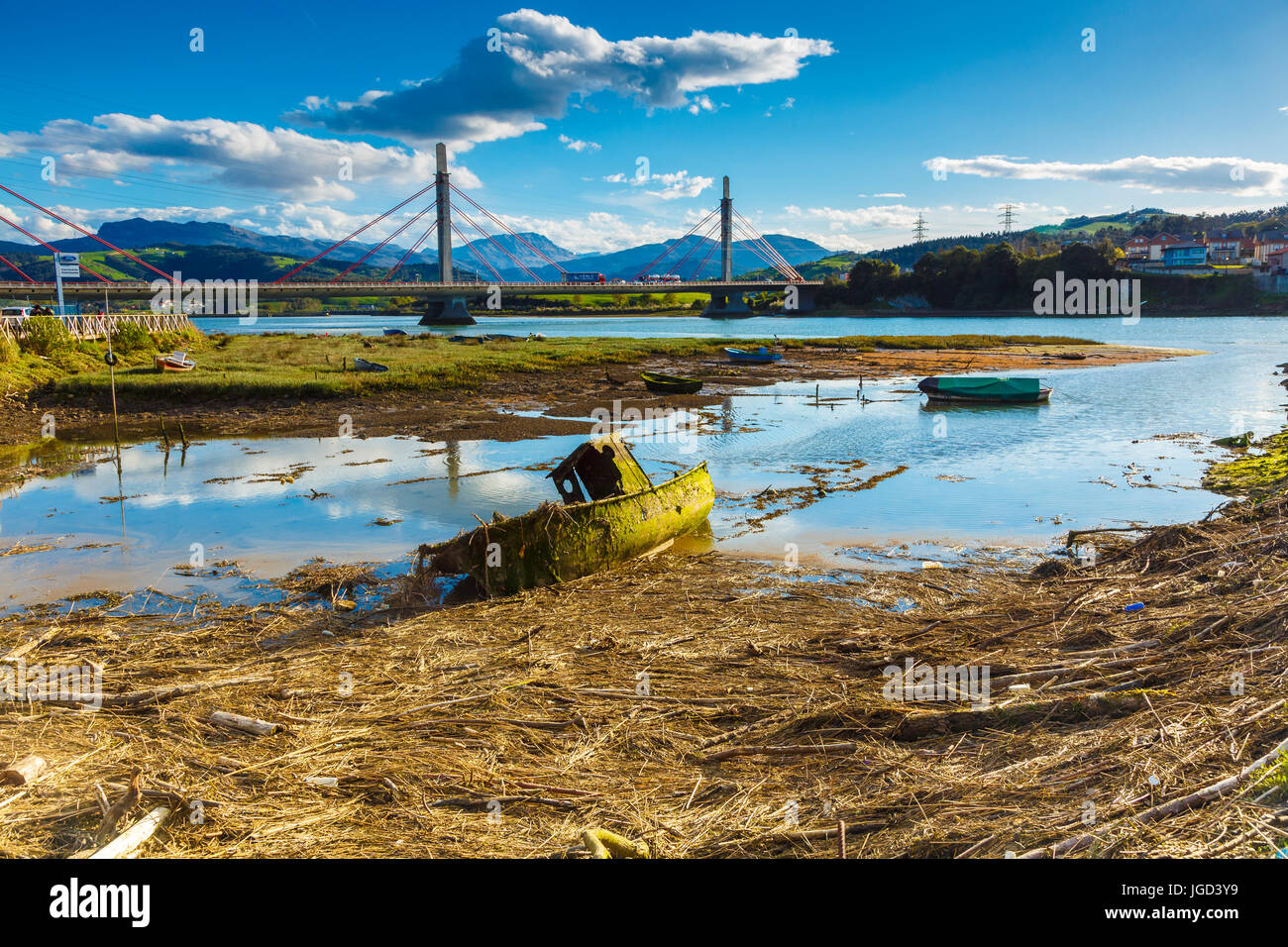 Old boat, bridge and tidal remains. - Stock Image
