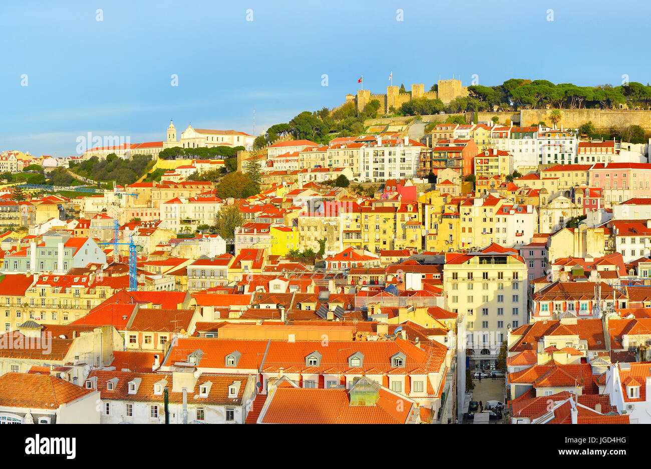 Old Twon of Lisbon with Lisbon Castle  at sunset. Portugal - Stock Image