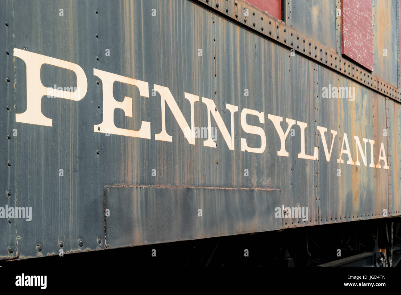 The side of an old rusty steam locomotive from Pennsylvania