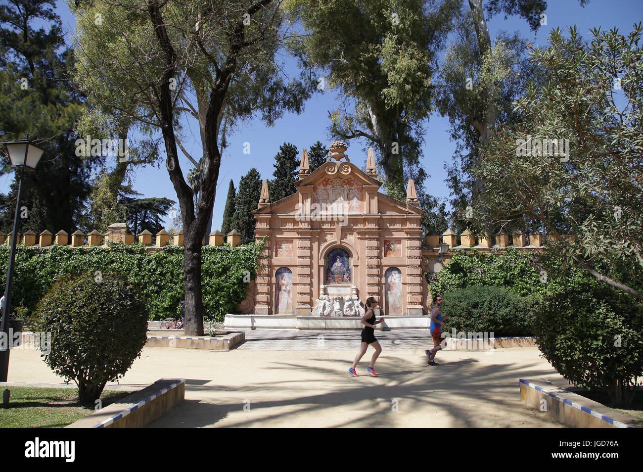 Joggers Monument Catalina de Ribera in the Jardines de Murillo Gardens Seville Spain - Stock Image