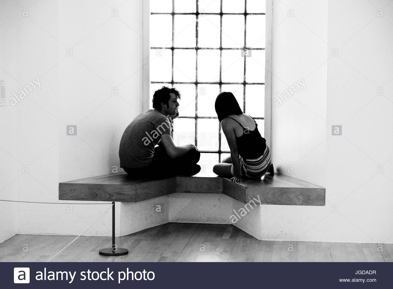 The Conversation. A young couple at the gallery. Liverpool, UK. - Stock Image