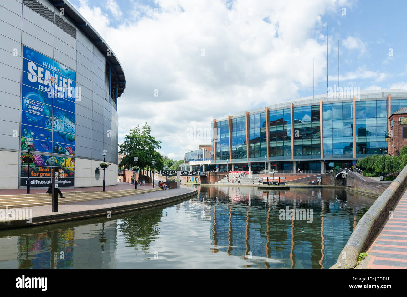 The Sea Life Centre and Barclaycard Arena by the canal running through Birmingham at Brindley Place - Stock Image