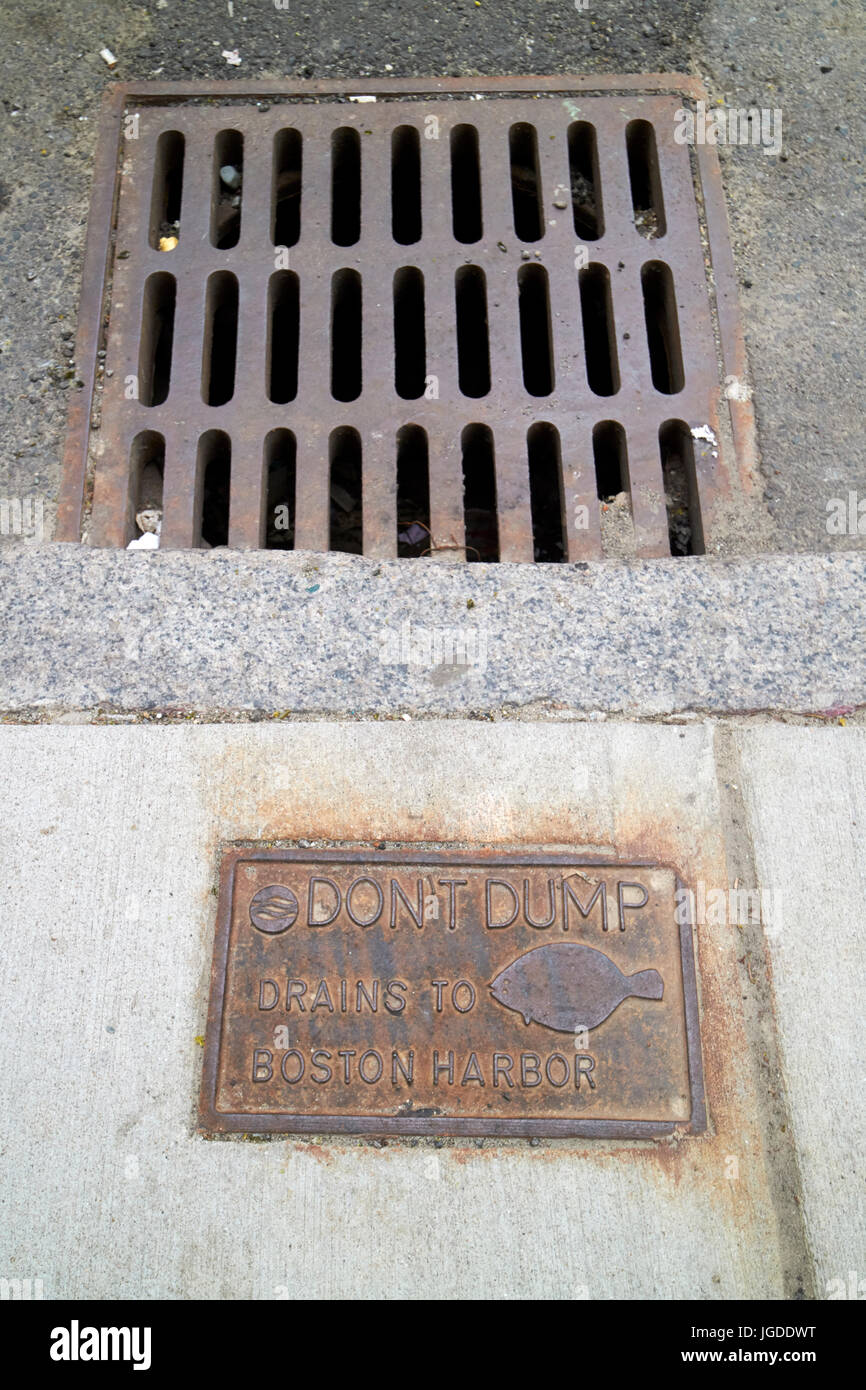 dont dump drains to boston harbor sign next to street level storm water drain Boston USA - Stock Image