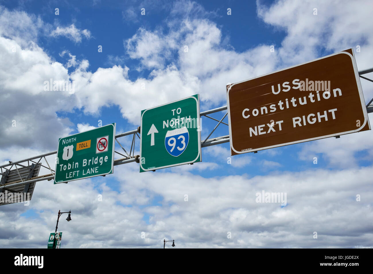 highway signs against blue cloudy sky for north us 1 tobin bridge north interstate 93 and uss constitution Boston - Stock Image