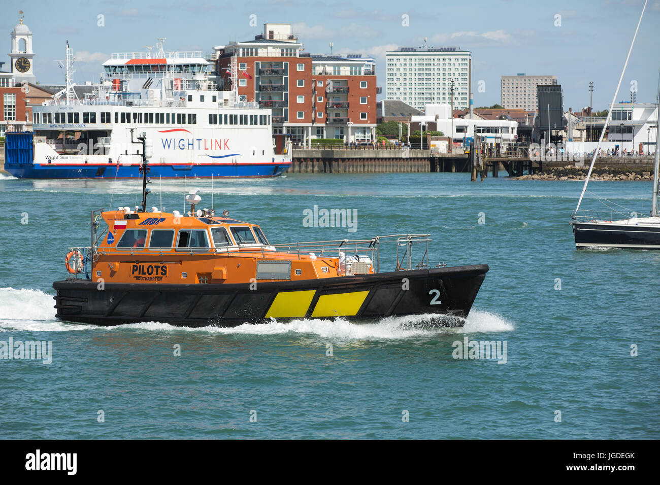 Orange and black Associated British Ports pilot boat in action in Portsmouth harbour. Nautical scene with the IOW - Stock Image