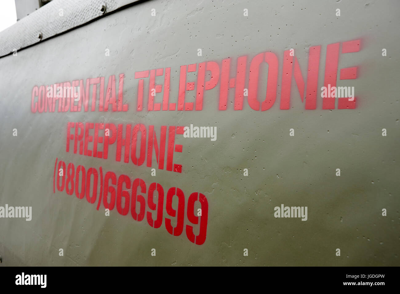 confidential telephone freephone number painted on the side of a british army landrover northern ireland troubles - Stock Image