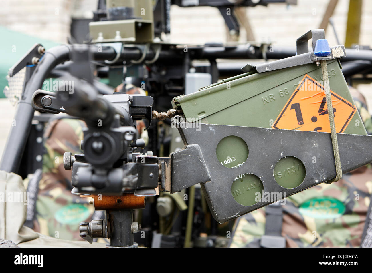 bullet belt loaded into general purpose machine gun weapon mounted on a british army vehicle uk - Stock Image