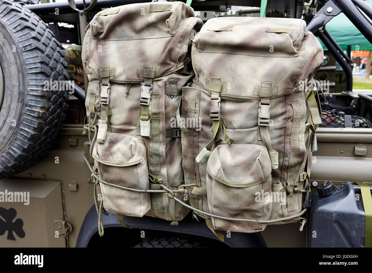 two british army special forces bergen backpacks attached to a landrover uk - Stock Image
