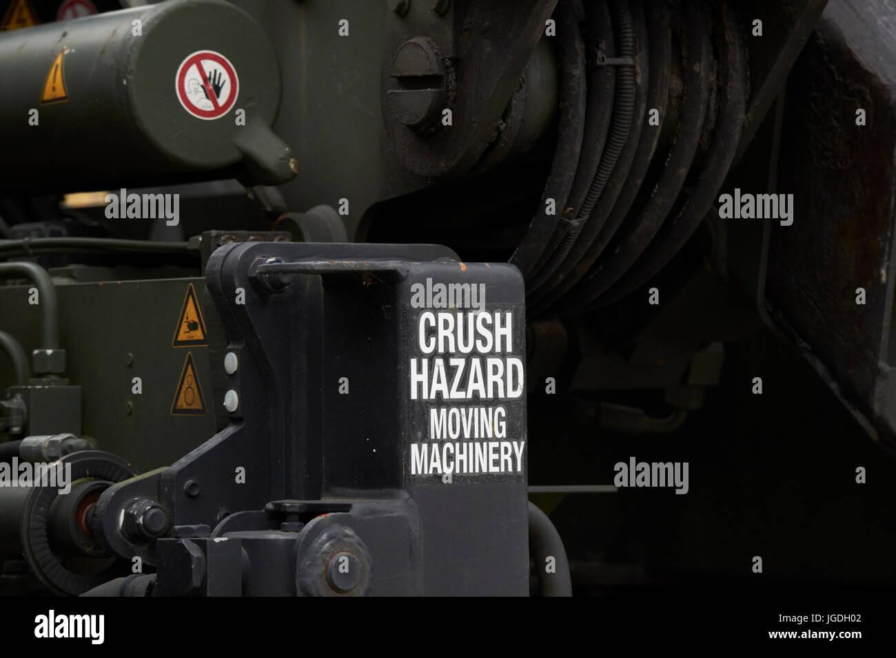 crush hazard moving machinery warning notice british army heavy lift vehicle uk - Stock Image