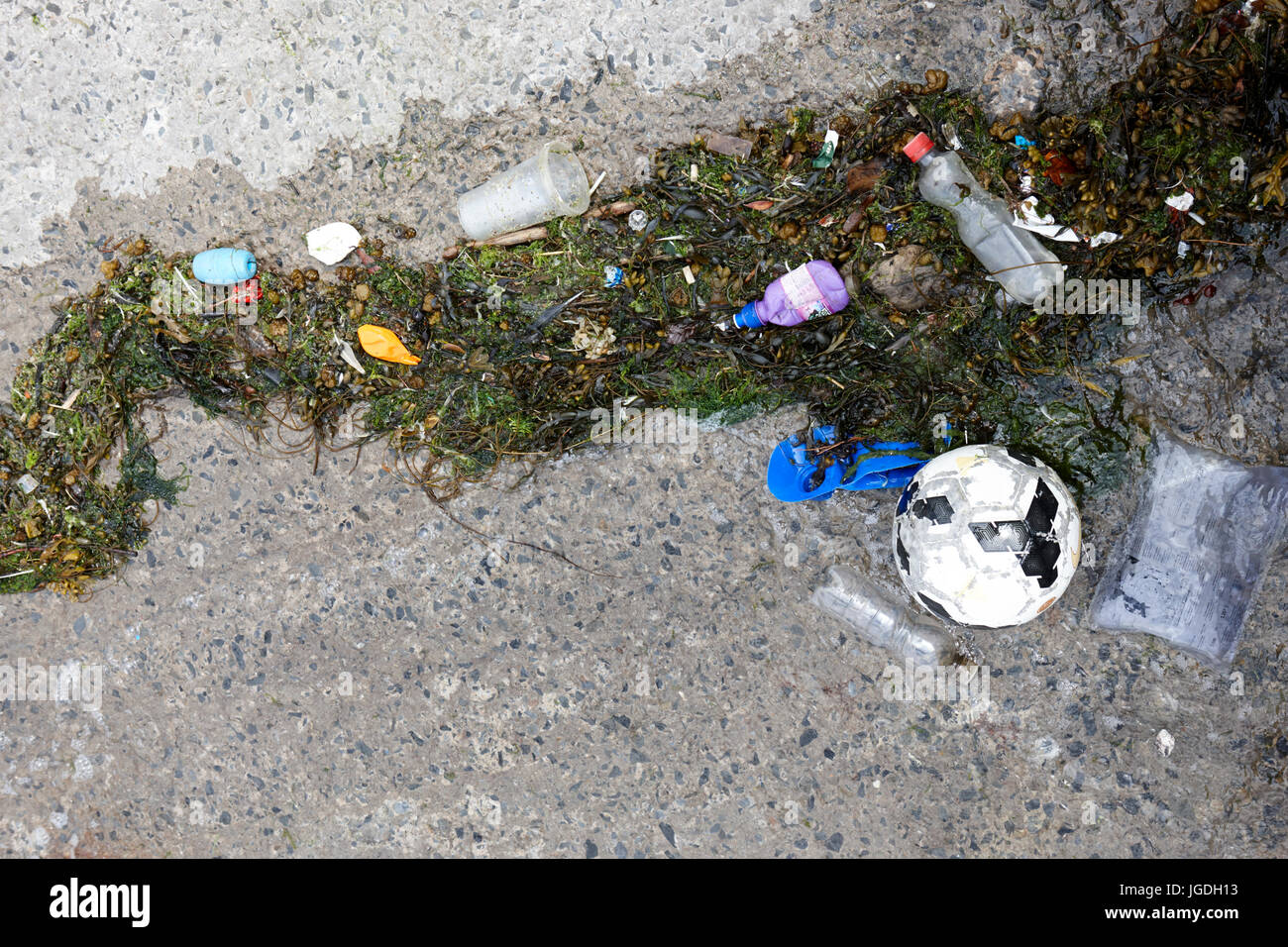 plastic waste washed up on slipway in the uk - Stock Image